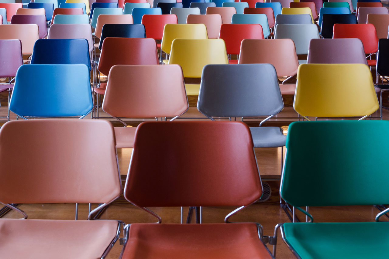 empty rows of colourful lecture theatre seats